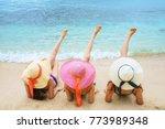 three women in white swimsuit... | Shutterstock . vector #773989348