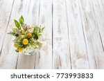 bouquet of flowers on a old... | Shutterstock . vector #773993833