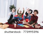 young happy students sitting... | Shutterstock . vector #773995396
