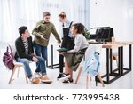 cheerful young students with...   Shutterstock . vector #773995438