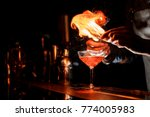 barman s hands making a fresh... | Shutterstock . vector #774005983