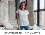 sexy woman in a white t shirt.... | Shutterstock . vector #774021946