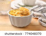 ramekin and spoon with corn... | Shutterstock . vector #774048370