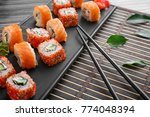 tray with tasty sushi rolls on... | Shutterstock . vector #774048394