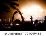 silhouettes of hand in concert... | Shutterstock . vector #774049468