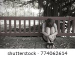 young woman sitting alone | Shutterstock . vector #774062614
