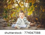 smiling baby girl sdending time ... | Shutterstock . vector #774067588