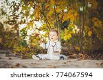 smiling baby girl sdending time ... | Shutterstock . vector #774067594