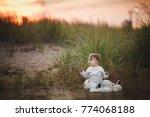 smiling baby girl sdending time ... | Shutterstock . vector #774068188