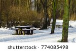 Snow Covered Picnic Table And...
