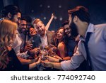 group of friends celebrating at ... | Shutterstock . vector #774092740