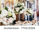 tall vases with roses stand on... | Shutterstock . vector #774115204
