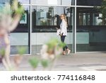 yong female entering the office ... | Shutterstock . vector #774116848