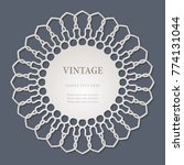 round lace cutout frame with... | Shutterstock .eps vector #774131044