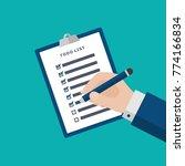 businessman hand filling... | Shutterstock .eps vector #774166834