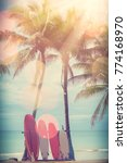 surfboard and palm tree on... | Shutterstock . vector #774168970