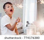 little boy plays with a bengal... | Shutterstock . vector #774176380