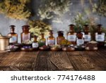 Small photo of Alternative medicine. Mortar, herbs, rustic wooden table.