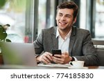 happy business man sitting by... | Shutterstock . vector #774185830