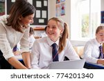 female teacher helping pupil... | Shutterstock . vector #774201340