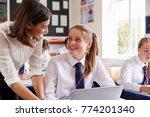 female teacher helping pupil... | Shutterstock . vector #774201340