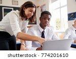 female teacher helping pupil... | Shutterstock . vector #774201610