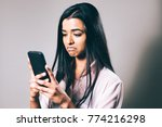 woman unimpressed with mobile... | Shutterstock . vector #774216298