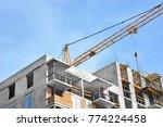 crane and building under... | Shutterstock . vector #774224458