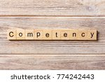 competency word written on wood ... | Shutterstock . vector #774242443