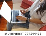 business woman typing on laptop ... | Shutterstock . vector #774244438