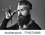 young handsome bearded man with ... | Shutterstock . vector #774271000