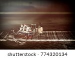 old sailboat in a broken glass... | Shutterstock . vector #774320134