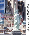 las vegas background copy of statue of liberty , rollercoaster and building - stock photo