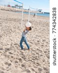 Small photo of Boy play volleyball on beach. Active life. Activity in sunny day.