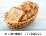 toast bread in basket on blue... | Shutterstock . vector #774365320