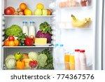 open fridge full of vegetables... | Shutterstock . vector #774367576