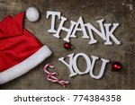 red santa hat on a textured... | Shutterstock . vector #774384358