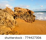 rugged rocks jut out of the... | Shutterstock . vector #774427306
