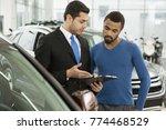 professional car dealer selling ... | Shutterstock . vector #774468529