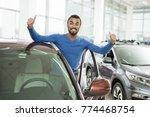 happy african man standing near ... | Shutterstock . vector #774468754