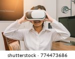 a woman wearing virtual reality ... | Shutterstock . vector #774473686