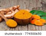 turmeric powder and fresh... | Shutterstock . vector #774500650