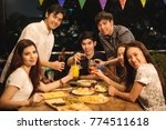 friends having party on the... | Shutterstock . vector #774511618