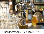 glass of light beer  serving... | Shutterstock . vector #774523114