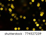 christmas bokeh background.... | Shutterstock . vector #774527239