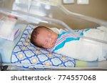 sleeping baby boy resting in a... | Shutterstock . vector #774557068