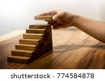 business man hand put wooden... | Shutterstock . vector #774584878
