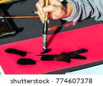 calligrapher writing words on... | Shutterstock . vector #774607378