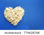 heart made of popcorn on color... | Shutterstock . vector #774628768