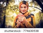 muslim woman using smart phone ... | Shutterstock . vector #774630538